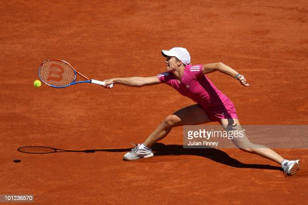 Justine Henin of Belgium stretches for a forehand during the women's singles second round match between Justine Henin of Belgium and Klara Zakopalova...