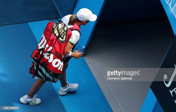 Justine Henin of Belgium walks off after the third round match against Svetlana Kuznetsova of Russia during day five of the 2011 Australian Open at...