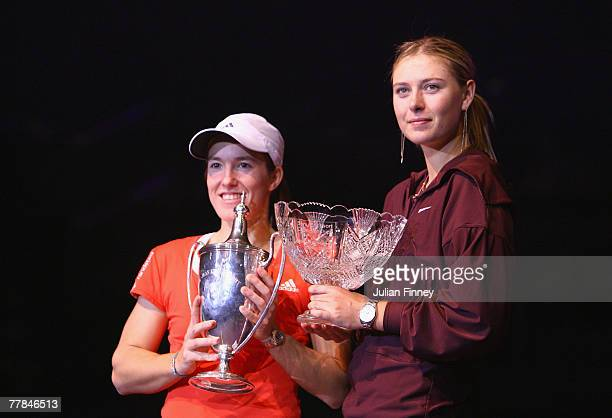 Justine Henin of Belgium with the trophy with Maria Sharapova of Russia after Henin won in the final during day six of the Sony Ericsson WTA Tour...