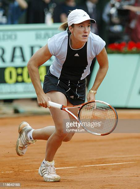 Justine HeninHardenne charges the net versus Mary Pierce in the final of the French Open at Roland Garros Stadium June 4 2005 HeninHardenne defeated...