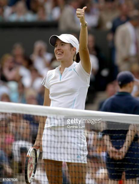 Justine Henin-Hardenne of Belgium celebrates her 6-4, 7-6, victory over Belgium's Kim Clijsters in the semi-final of the 2006 Wimbledon Championships...