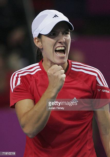 Justine Henin-Hardenne of Belgium celebrates winning a point in her match against Francesca Schiavone of Italy during the Fed Cup by BNP Paribas...