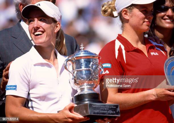 Justine HeninHardenne of Belgium celebrates with the trophy after defeating Kim Clijsters of Belgium in the Women's Singles Final of the French Open...