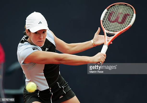 Justine HeninHardenne of Belgium plays a backhand against Maria Sharapova of Russia during the Qatar Total German Open May 6 2005 in Berlin Germany