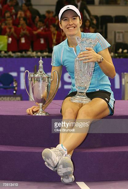 Justine HeninHardenne of Belgium poses with the Championship trophy and the Billie Jean King trophy after defeating Amelie Mauresmo of France during...