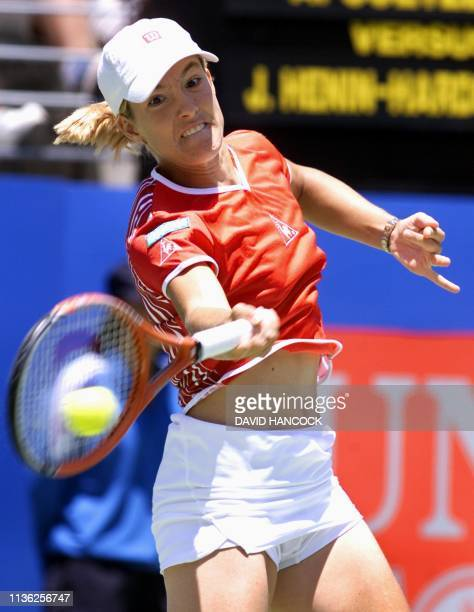 Justine Henin-Hardenne of Belgium powers a forehand return to Amanda Coetzer of South Africa in the quarter finals of the Sydney International tennis...