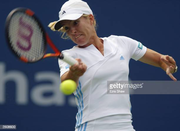 Justine HeninHardenne of Belgium returns a shot to Aniko Kapros of Hungary during the US Open at the USTA National Tennis Center on August 26 2003 in...