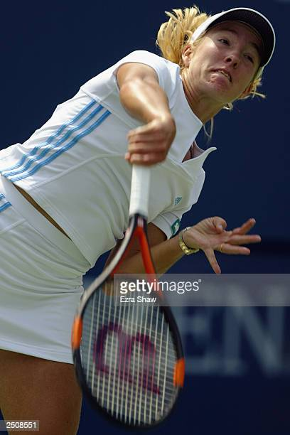 Justine HeninHardenne of Belgium serves to Aniko Kapros of Hungary during the US Open at the USTA National Tennis Center on August 26 2003 in...