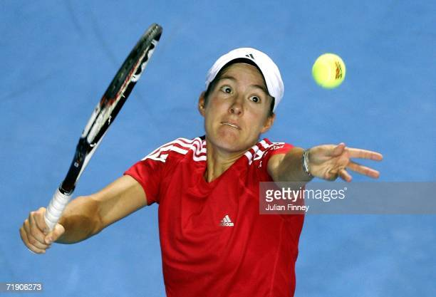 Justine HeninHardenne of Belgium serves to Flavia Pennetta of Italy during the Fed Cup by BNP Paribas Final between Belgium and Italy at the...