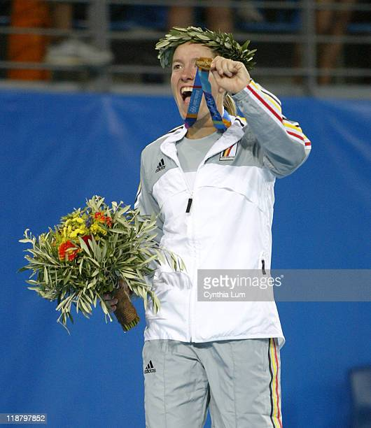 Justine Henin-Hardenne of Belgium takes the gold, defeating Aimelie Mauresmo of France in 6-3, 6-3 in the final of women single tennis at the...