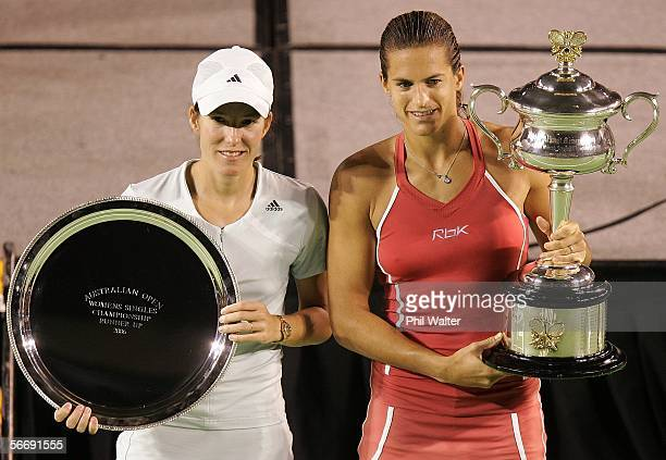 Justine HeninHardenne of Belguim and Amelie Mauresmo of France pose for photographers after their Women's Singles Final match during day thirteen of...