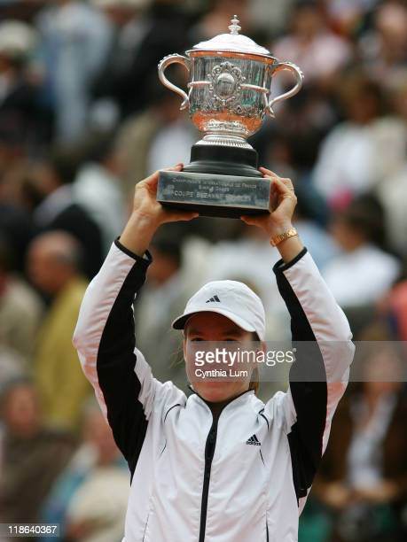 Justine Henin-Hardenne raises the winner's trophy after the French Open final. Henin-Hardenne defeated Mary Pierce 6-1, 6-1 at Roland Garros Stadium,...
