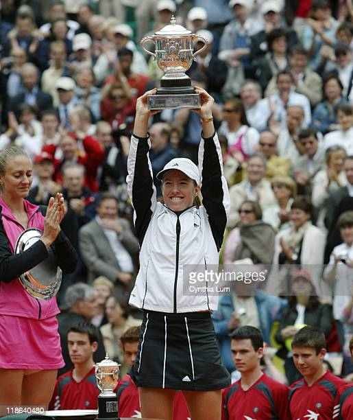Justine HeninHardenne raises the winner's trophy after the French Open final HeninHardenne defeated Mary Pierce 61 61 at Roland Garros Stadium Paris...