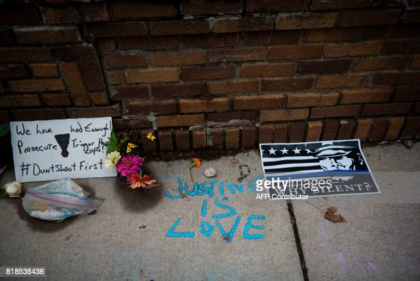 'Justine is Love' is written on the sidewalk at a makeshift memorial for Justine Damond on July 18 2017 in Minneapolis Minnesota Scrutiny intensified...