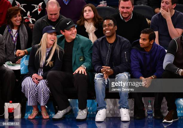 Justine Karain Reed Patrick Reed Chris Rock and Aziz Ansari attend New York Knicks Vs Cleveland Cavaliers at Madison Square Garden on April 9 2018 in...
