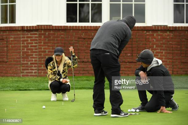 Justine Karain, wife of Patrick Reed of the United States, watches as he putts during a practice round prior to the 2019 PGA Championship at the...