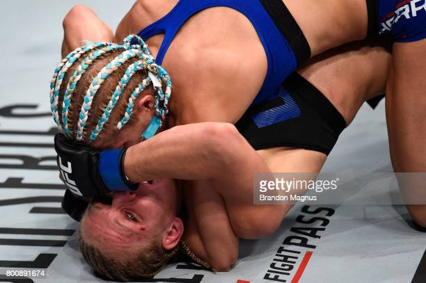 Justine Kish defends against a submission attempt from Felice Herrig in their women's strawweight bout during the UFC Fight Night event at the...
