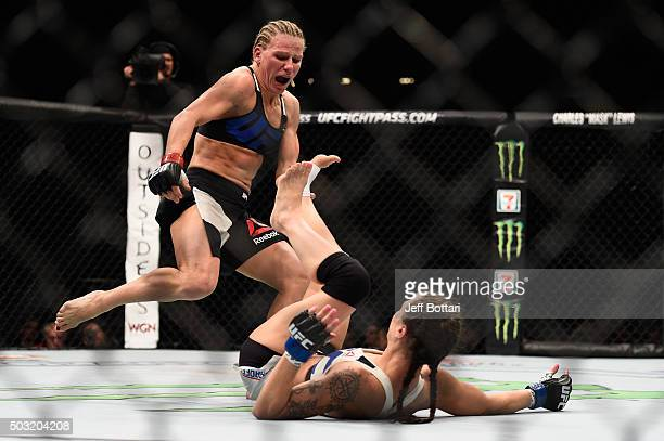 Justine Kish kicks Nina Ansaroff in their women's strawweight bout during the UFC 195 event inside MGM Grand Garden Arena on January 2 2016 in Las...