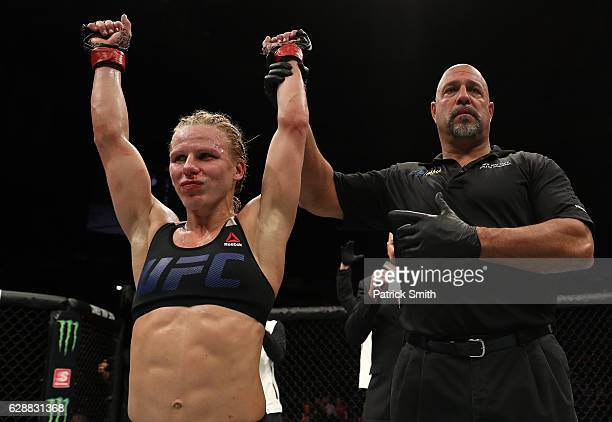 Justine Kish of Russia celebrates her unanimousdecision victory over Ashley Yoder in their womens strawweight bout during the UFC Fight Night event...