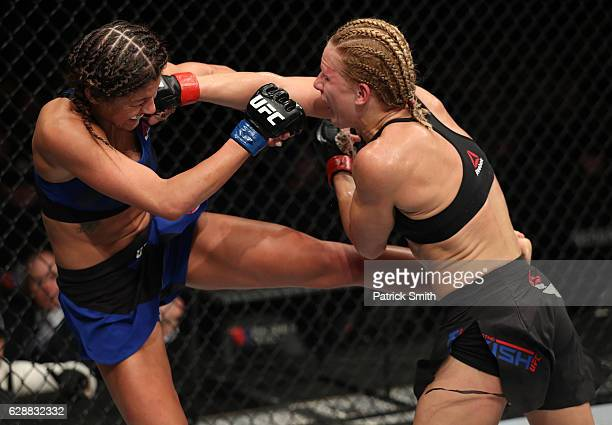Justine Kish of Russia punches Ashley Yoder in their womens strawweight bout during the UFC Fight Night event at the Times Union Center on December 9...