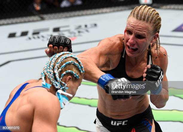 Justine Kish punches Felice Herrig in their women's strawweight bout during the UFC Fight Night event at the Chesapeake Energy Arena on June 25 2017...