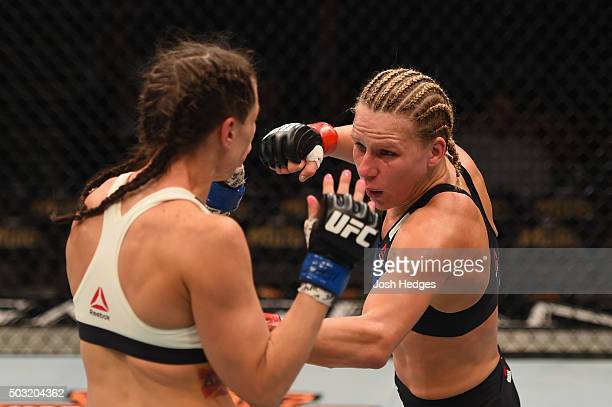Justine Kish punches Nina Ansaroff in their women's strawweight bout during the UFC 195 event inside MGM Grand Garden Arena on January 2 2016 in Las...