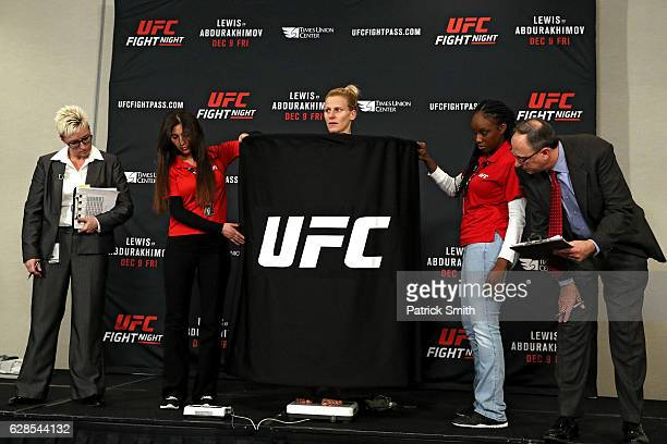 Justine Kish stands on the scale during UFC Fight Night weighins at the Hilton Albany on December 8 2016 in Albany New York