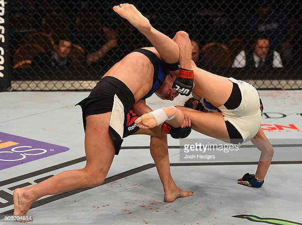 Justine Kish takes down Nina Ansaroff in their women's strawweight bout during the UFC 195 event inside MGM Grand Garden Arena on January 2 2016 in...