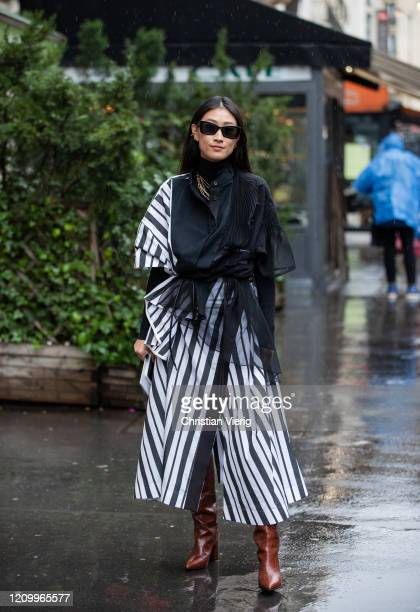 Justine Lee is seen wearing black white striped coat outside Sacai during Paris Fashion Week - Womenswear Fall/Winter 2020/2021 : Day Eight on March...
