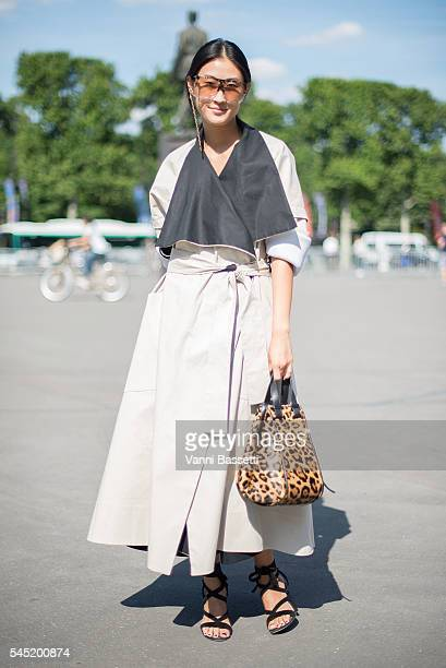 Justine Lee poses wearing a Maticevski coat before the Zuhair Murad show at the Grand Palais during Paris Fashion Week Haute Couture FW 16/17 on July...