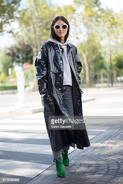 Justine Lee poses wearing an Isabel Marant coat and Vetements shoes after the Celine show at the Tennis Club de Paris during Paris Fashion Week...