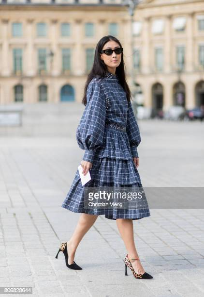 Justine Lee wearing a plaid dress outside Schiaparelli during Paris Fashion Week Haute Couture Fall/Winter 20172018 Day Two on July 3 2017 in Paris...