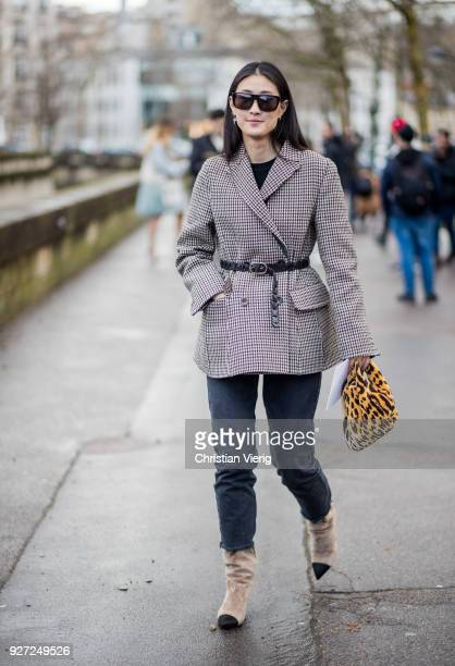 Justine Lee wearing belted jacket Chanel boots leopard print bag is seen outside Valentino during Paris Fashion Week Womenswear Fall/Winter 2018/2019...