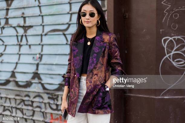 Justine Lee wearing white pants blazer with print outside Maison Margiela during Paris Fashion Week Haute Couture Fall/Winter 20172018 Day Four on...