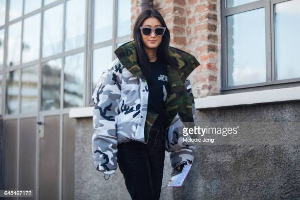Justine Lee wears a camoflage Canada Goose x Vetements puffer jacket outside Missoni during Milan Fashion Week Fall/Winter 2017/18 on February 25...