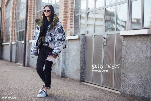 Justine Lee wears a camoflage Canada Goose x Vetements puffer jacket and Dolce Gabbana sneakers outside Missoni during Milan Fashion Week Fall/Winter...