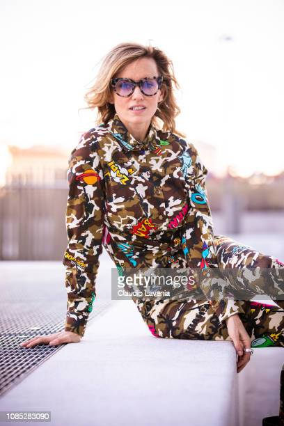 Justine Mattera wearing Ultrachic camouflage shirt and leggings and Saturninoeyewear is seen on December 10 2018 in Milan Italy