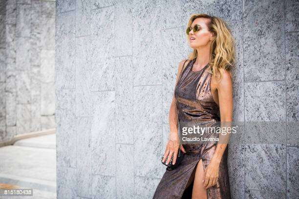 Justine Mattera wears a Winonah dress and Eyeslazer sunglasses on July 10 2017 in Milan Italy