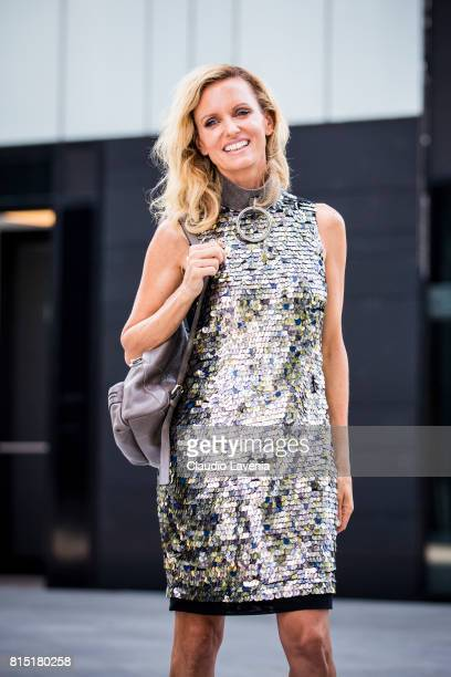 Justine Mattera wears French Connection dress Absidem necklace and a Coccinelle backpack on July 10 2017 in Milan Italy