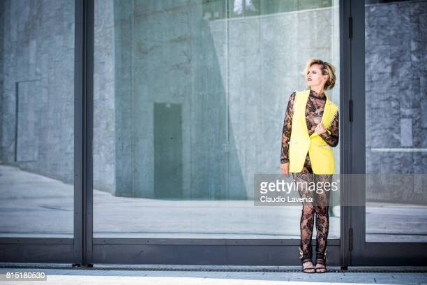 Justine Mattera wears Mila Schon top and pants Piccione Piccione yellow gilet and Paola Cadematori shoes on July 10 2017 in Milan Italy