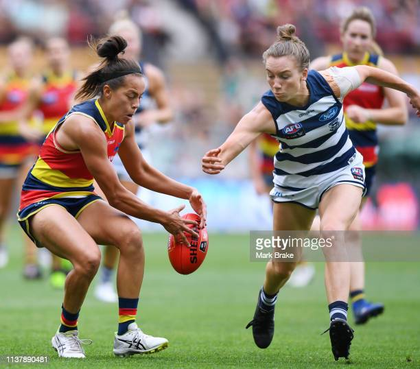 Justine Mules of the Adelaide Crows avoids Sophie Van De Heuvel of the Cats during the AFLW Preliminary Final match between the Adelaide Crows and...