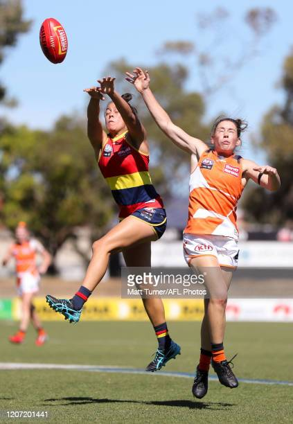 Justine Mules of the Crows and Jodie Hicks of the Giants compete for the ball during the 2020 AFLW Round 06 match between the Adelaide Crows and the...