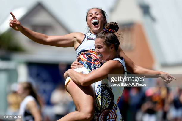 Justine Mules of the Crows celebrates a goal during the 2021 AFLW Round 05 match between the Adelaide Crows and the St Kilda Saints at Norwood Oval...