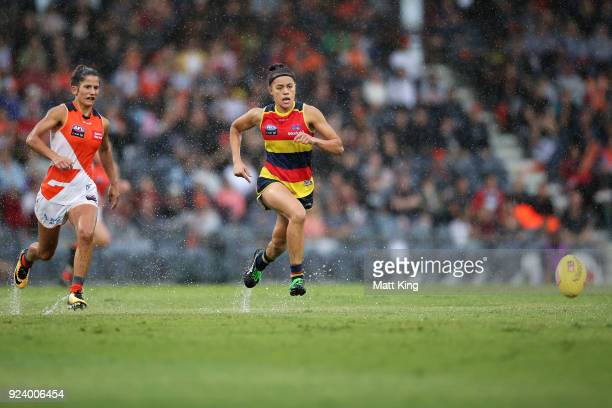 Justine Mules of the Crows competes for the ball against Jess Dal Pos of the Giants during the round four AFLW match between the Greater Western...