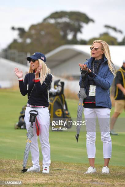 Justine Reed and Dowd Simpson watch their partners during the first round four-ball matches of the Presidents Cup at The Royal Melbourne Golf Club on...