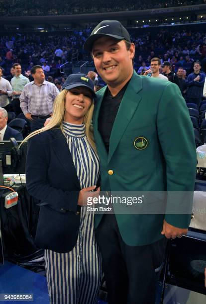 Justine Reed poses with her husband Patrick Reed at Madison Square Garden during the Masters winner media tour throughout New York City on April 9...