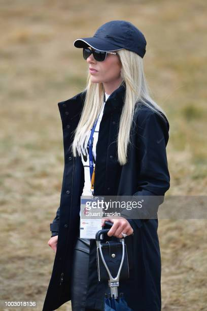 Justine Reed, watches her husband Patrick Reed of the United States during the third round of the 147th Open Championship at Carnoustie Golf Club on...