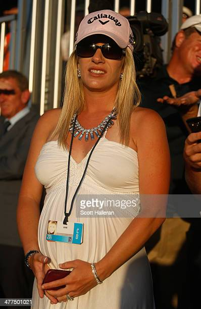 Justine Reed watches the play of her husband Patrick during the final round of the World Golf ChampionshipsCadillac Championship at Trump National...