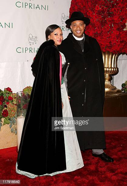 Justine Simmons and Reverend Run during Royal Birthday Ball for Sean P Diddy Combs Outside Arrivals at Cipriani in New York City New York United...