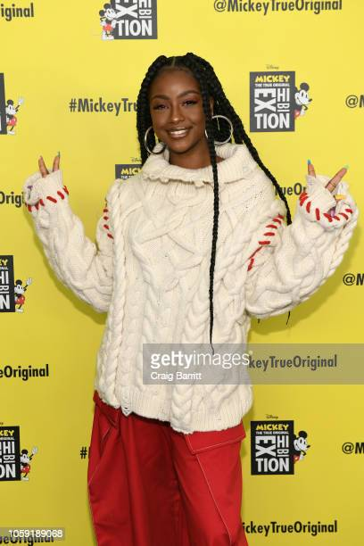 Justine Skye attends Mickey The True Original Exhibition reception to commemorate Mickey Mouse's 90th anniversary The 16000 squarefoot immersive...